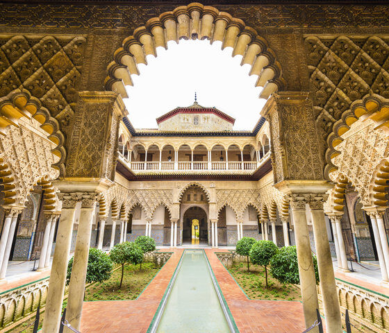 Seville, Spain - November 7, 2014: The Royal Alcazar of Seville at the Courtyard of the Maidens. It is the oldest royal palace still in use in Europe.